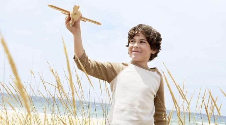 Child with Air-plane on Beach | Alpha Airport Parking