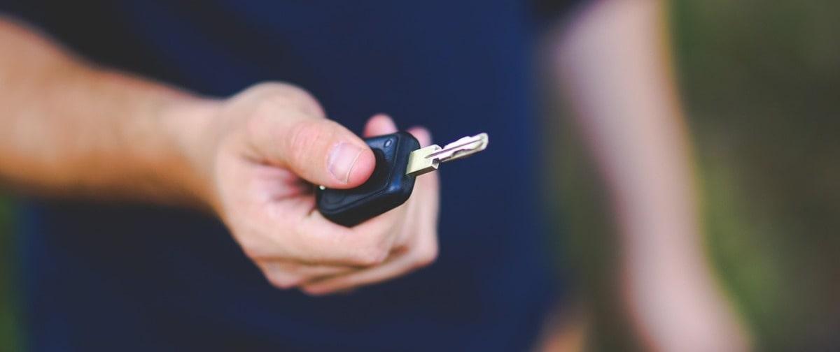Man holding a car key | Alpha Airport Parking